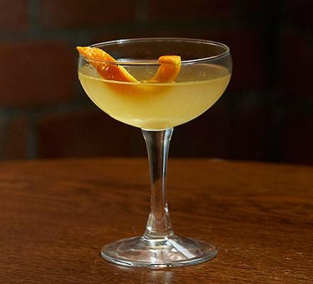 Breakfast martini with an orange zest garnish