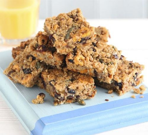 A pile of oaty breakfast bars on a cloth
