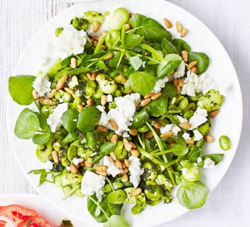 Broad bean, feta and watercress salad on a plate