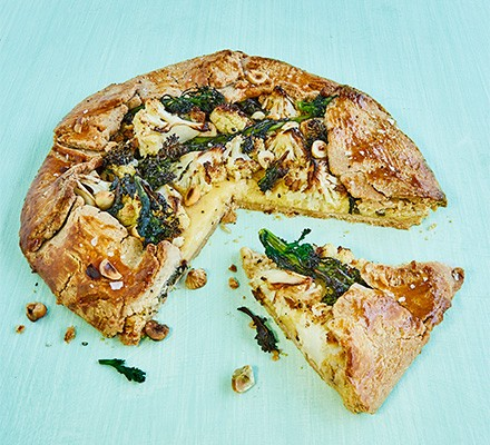 Broccoli & cauliflower cheese galette with hazelnut spelt pastry, cut into slices