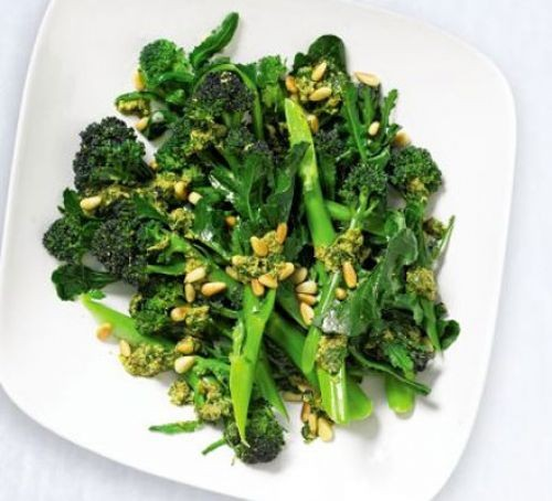Long stem broccoli with mint on a plate