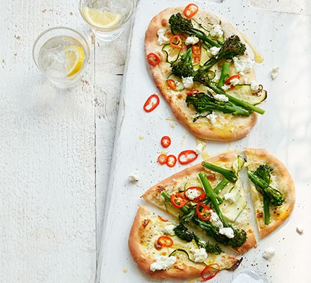 Broccoli & goat's cheese pizzettes served on a board