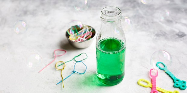 Homemade bubble mixture with bubble wands and paperclips