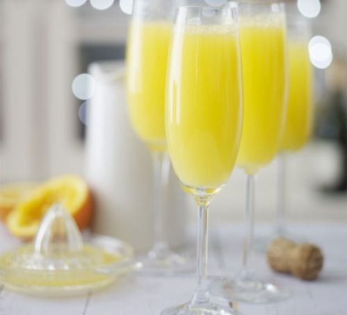 Flute glasses filled with Buck's fizz