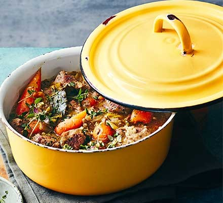 Buckwheat & spring lamb stew served in a yellow casserole dish