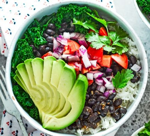 Bowl of vegetables, chopped avocado, black beans and rice