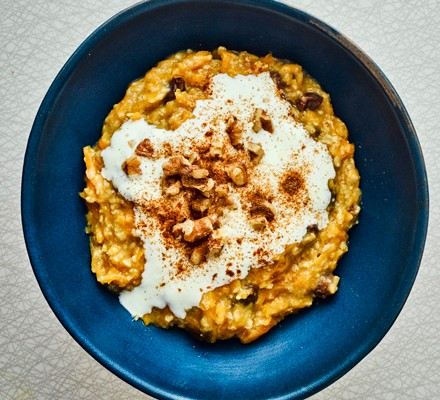 Butternut squash oats topped with yogurt and cinnamon in bowl