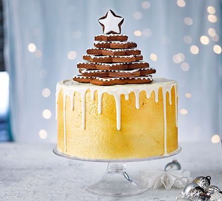 Pure gold Christmas drip cake displayed on a cake stand