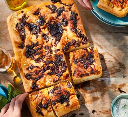 A caramelised onion focaccia cut into pieces
