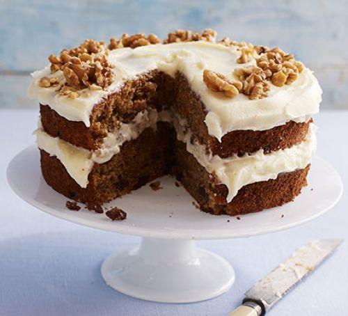 Carrot cake with cream cheese frosting on a cake stand