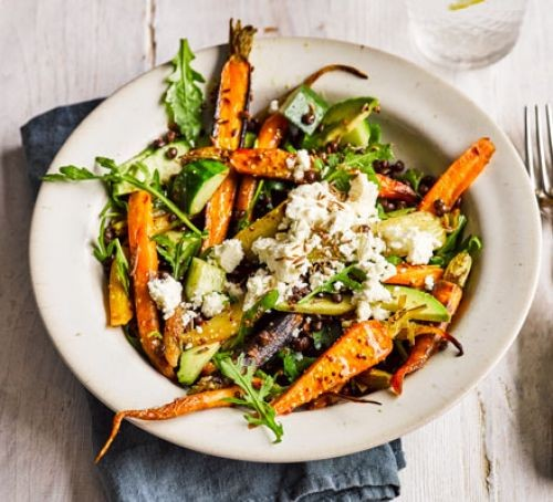 Roasted carrot, rocket and lentil salad in a dish