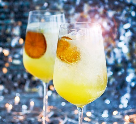 Cocktail with orange slices and ice