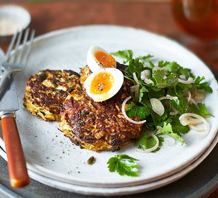 Celeriac & comté fritters served with a quail's egg and a side salad
