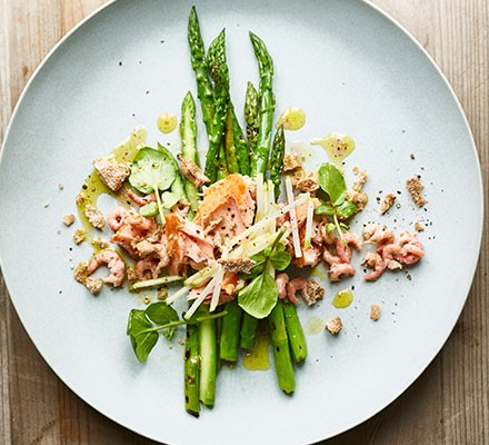 Charred asparagus, smoked salmon, shrimp & rye crumb served on a plate