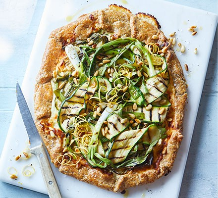 Charred courgette, lemon & goat's cheese galette served on a chopping board