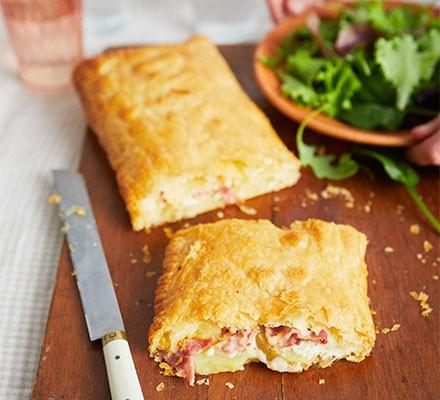 Ham, cheese & potato pie on a chopping board