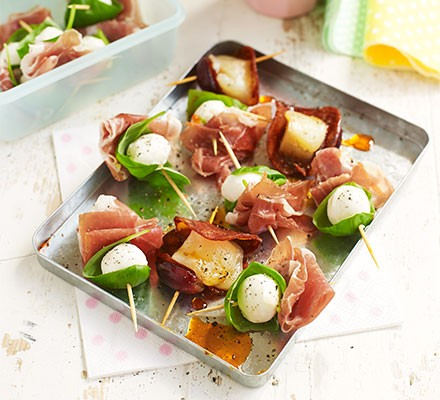 Cheese & chorizo or prosciutto skewers served on a tray
