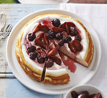 Lemon cheesecake with baked plums & blackberries