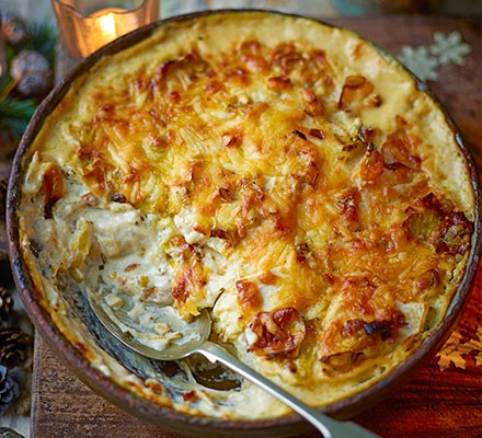 Cheesy celeriac, leek & rosemary gratin in a dish