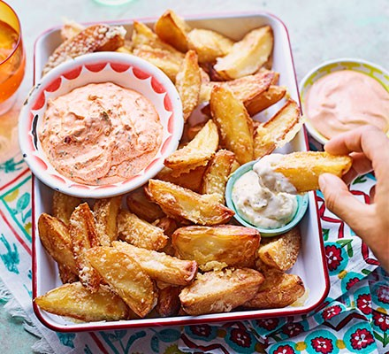 Cheesy chips 'n' dips served in a roasting dish