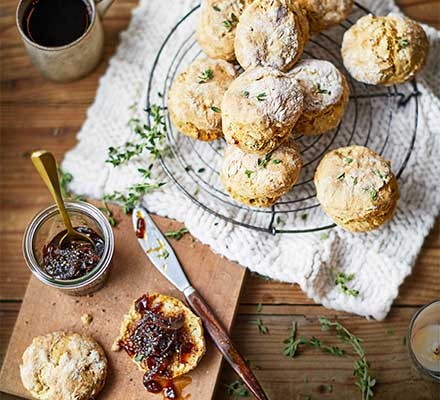 A chopping board with 'cheesy' vegan scones