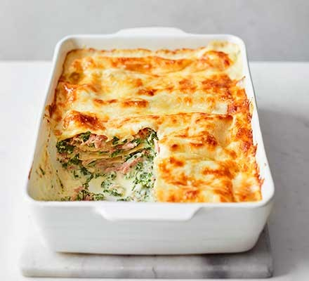 Cheesy ham hock, spinach & ricotta lasagne in a casserole dish