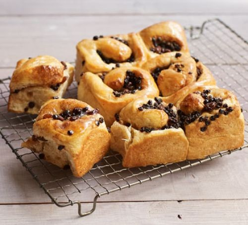 Chelsea buns on cooking rack
