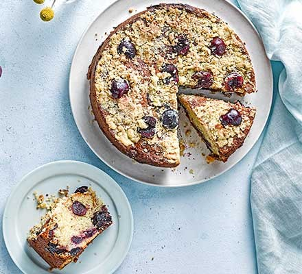 Cherry crumble cake cut into slices