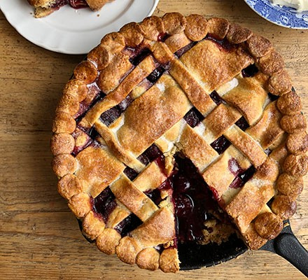 Cherry pie with a slice cut out