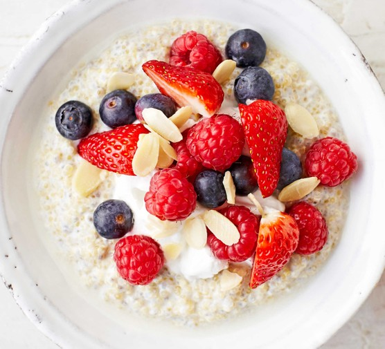 A bowl of porridge topped with fruits
