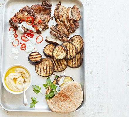 The ingredients for chicken & aubergine shawarma pittas laid out on a tray