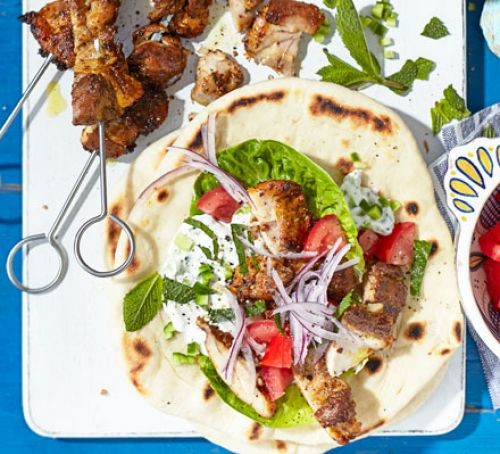 Chicken gyros kebabs with flatbread and salad
