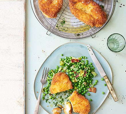 Chicken Kievs served on a plate with vegetables
