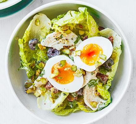 Chicken & pistachio salad served in a bowl