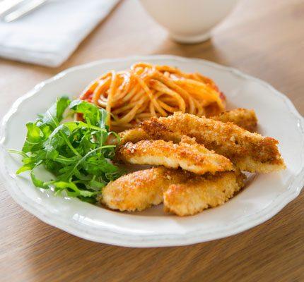 Chicken schnitzel strips with tomato spaghetti_image