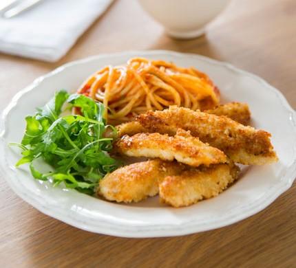 Chicken schnitzel strips with tomato spaghetti