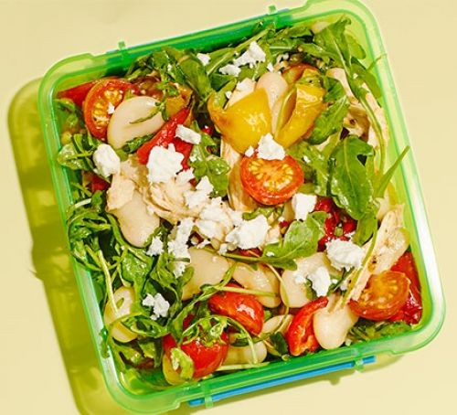 Chicken, butter bean and tomato salad in a green lunchbox
