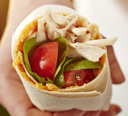 Chicken wrap with sticky sweet potato, salad leaves & tomatoes