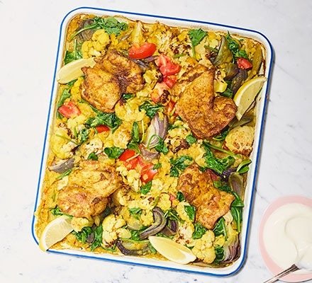 Curried chicken & baked dhal served in a casserole dish