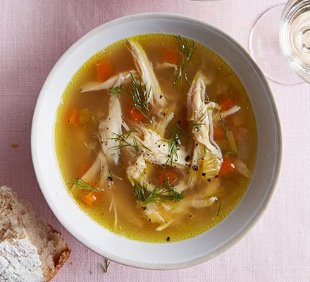 Slow cooker chicken soup served in a bowl