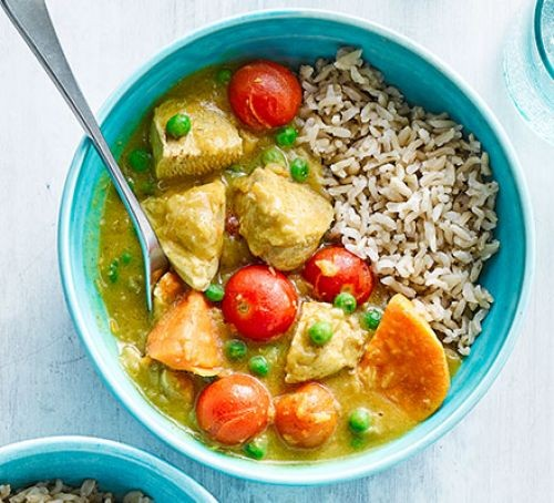 Bowl of sweet potato and vegetable curry with rice