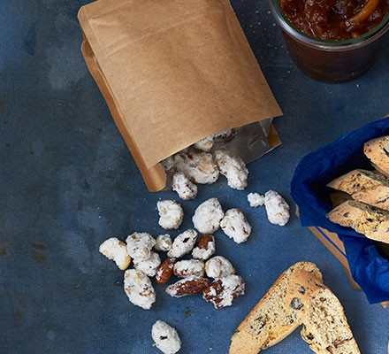 Chilli & fennel frosted nuts spilling out of a paper bag
