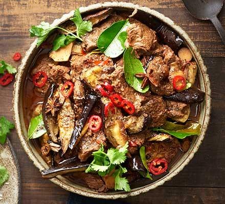 A casserole dish serving Chinese beef & aubergine hotpot
