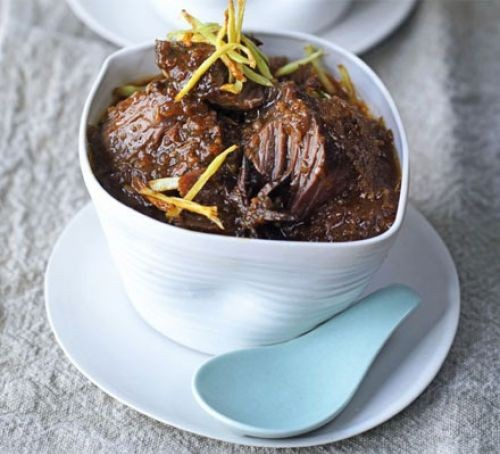 Braised beef in an oval raised dish
