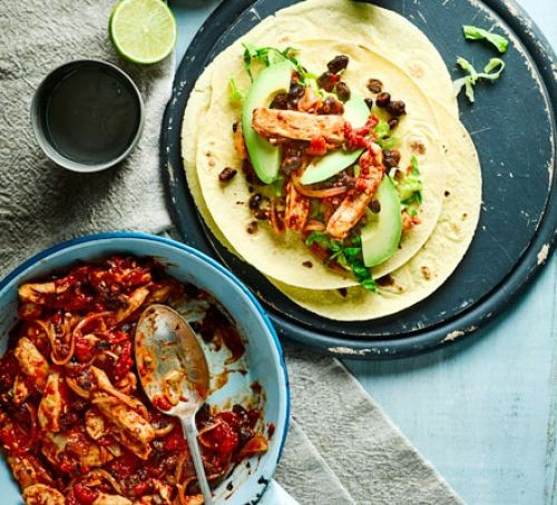 Vegetable tortillas next to bowl of chipotle chicken filling