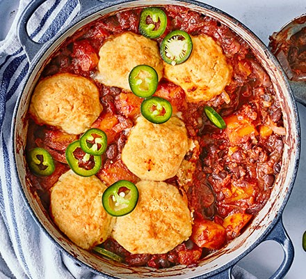 Chipotle sweet potato & black bean stew with cheddar dumplings served in a casserole dish