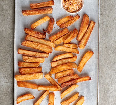 chips on sheet pan on grey background