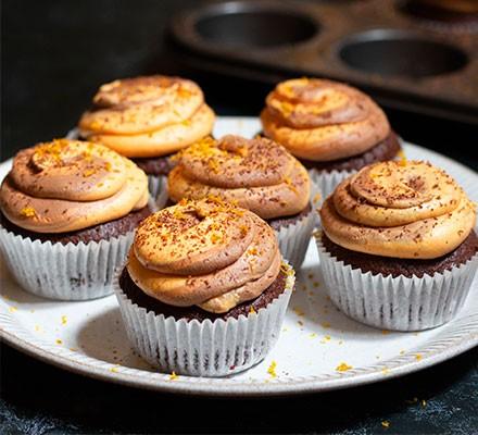 Six chocolate orange cupcakes