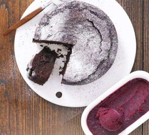 Chocolate torte on a plate with cherry sorbet side
