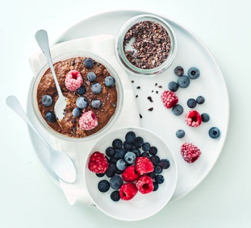 Chocolate chia pudding with mixed berries and chia seeds